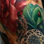 Realistic roses with locket and lady bug color tattoo, Brent Olson Art Junkies Tattoo Tattoo Design Thumbnail