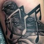 Swallow with Music Notes Tattoo Design Thumbnail