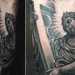 Realistic Angel Carrying a Cross in Black and Gray Tattoo Design Thumbnail