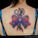 Abstract color ribbon and scissors Tattoo Design Thumbnail