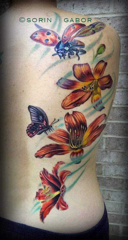 Nature Animal Ladybug - Realistic lilies, lady bug, and butterly half back feminine tattoo