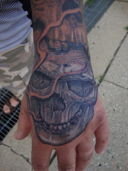 tattoos/ - Skully Hand - 122701