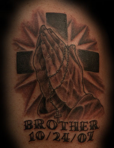 Rosary beads and praying hands Tattoo. Tattooed by Ray at The Tattoo Studio,