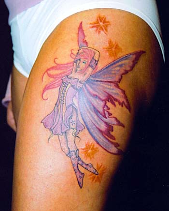 Source url:http://tattoomenow-tattoo.blogspot.com/2009/12/moon-star-fairy-
