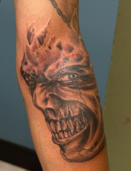Tattoos evil grim reaper tattoos evil face for Evil faces tattoos