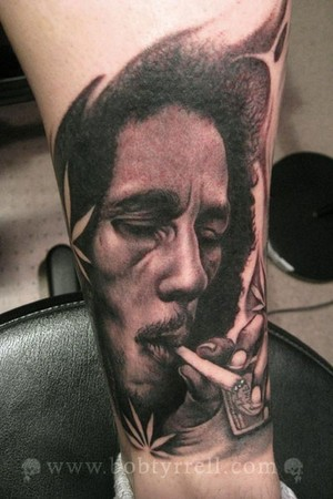 Fernando has tattoos on of both of his inner arms. tattoo bob marley