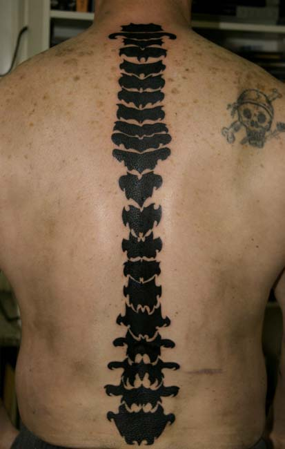 It is Victoria Beckham's Hebrew tattoo on her spine. Spine tribal tattoos