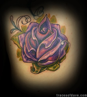 Purple Rose: The purple rose symbolize love at first site and these tattoos
