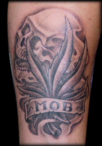 An interesting way to enrich the basic scale tattoo is to add the image of