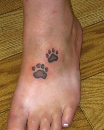 Comments: This is the client's actual dog's prints tattooed on her foot.