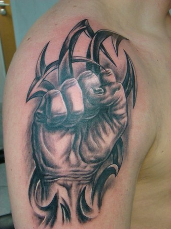 Daniel Dudek - Fist tribal tattoo