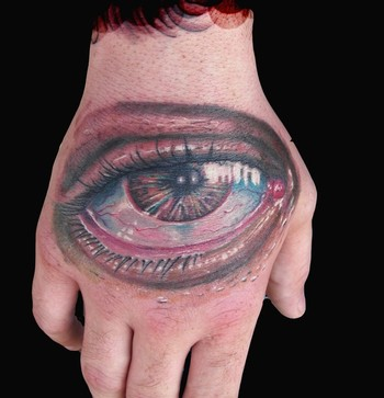 Isnard Barbosa - Eye ball hand tattoo