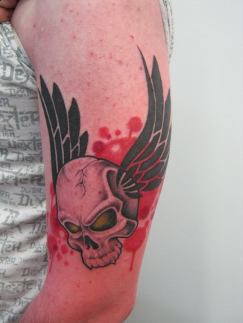 Looking for unique Tattoos? Custom flying skull tattoo
