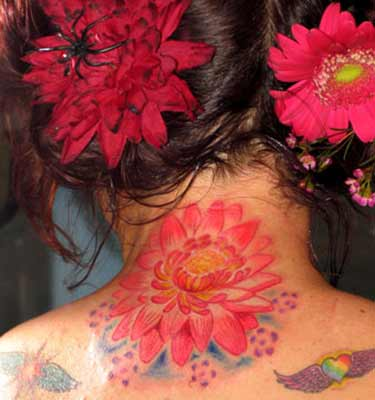tattoos for back of neck. flower tattoo on ack of neck