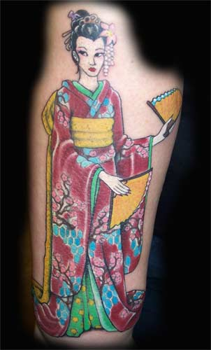 A Japanese geisha tattooed on the back of the arm of the world traveler,