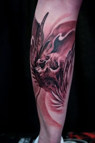 skull wings tattoos. Skull with wings, done at the