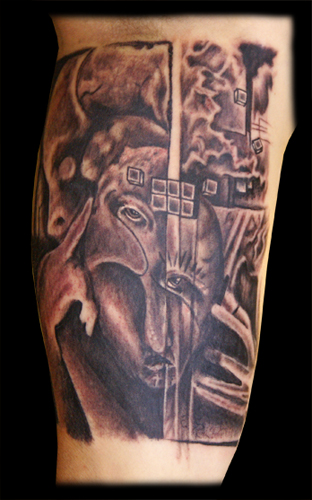 Comments: An inner arm tattoo featuring black and grey faces and eyes.