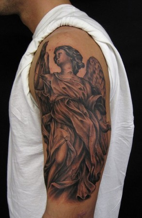Comments: Stone angel statue arm tattoo done from a statue reference.