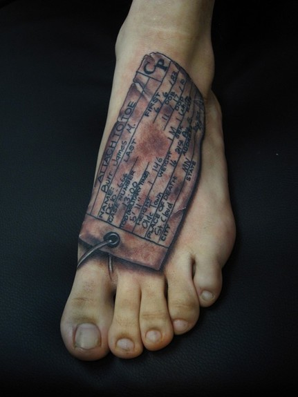 Jon von Glahn - Toe tag black and grey foot tattoo