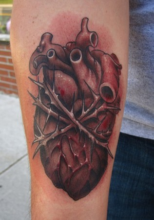 squeezed-anatomical-heart-black-and-grey-tattoo-with-red