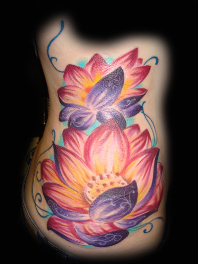 girls tattoos with lotus flower tattoos and KOI FISH TATTOOS on shoulder