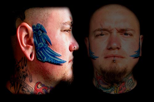 face tattoos. bio organic face tattoo