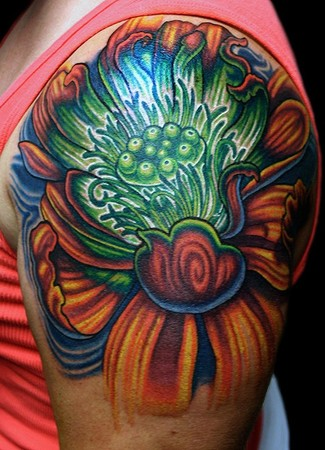 Comments: Lotus Flower on Shoulder with green glow center