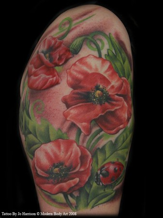 tattoo pictures of flowers. Red Flowers Tattoo