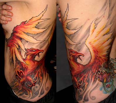 Comments: Custom color fire phoenix rib tattoo
