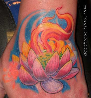 Looking for unique Tattoos? lotus with flames color tattoo