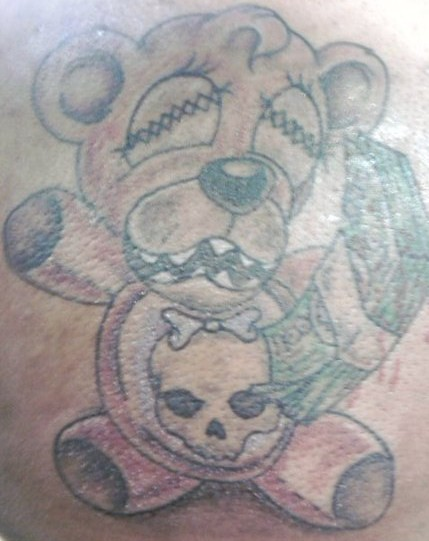 Tattoos · Page 1. teddy bear with skull and money