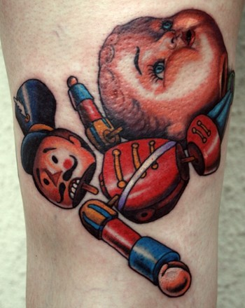 Tattoos · Shawn Barber. doll head with toy soldier