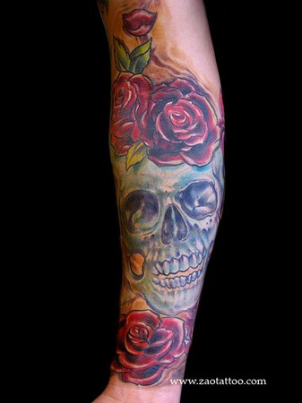 small rose tattoos. Skull and Roses Tattoo