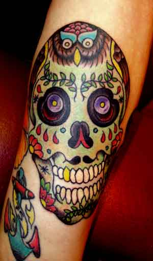 day of dead tattoos for women. day of the dead skull tattoo.
