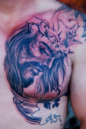 Comments: Chest plate Jesus tattoo, black and gray tattoo in progress.