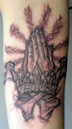 budding series of sketchy-style tattoosthis tattoo on the underarm,