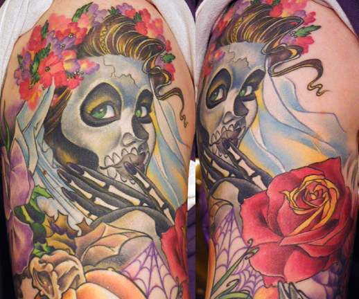 That tattoo artist needs a medal. Day Of The Dead skull ladies are becoming